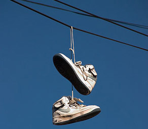 Why Tennis Shoes On Power Lines